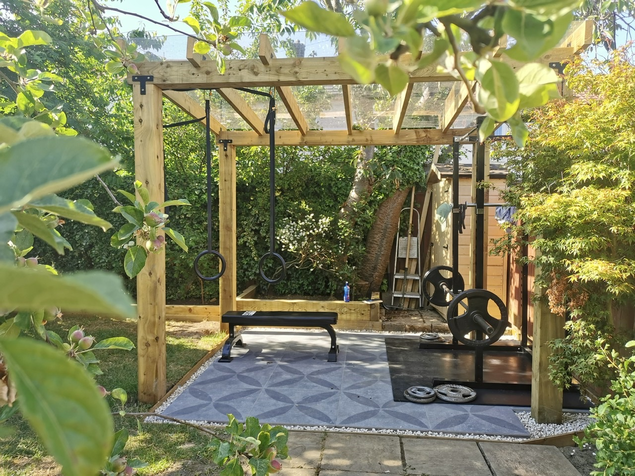 Outdoor garden gym with squat rack and gymnastic rings